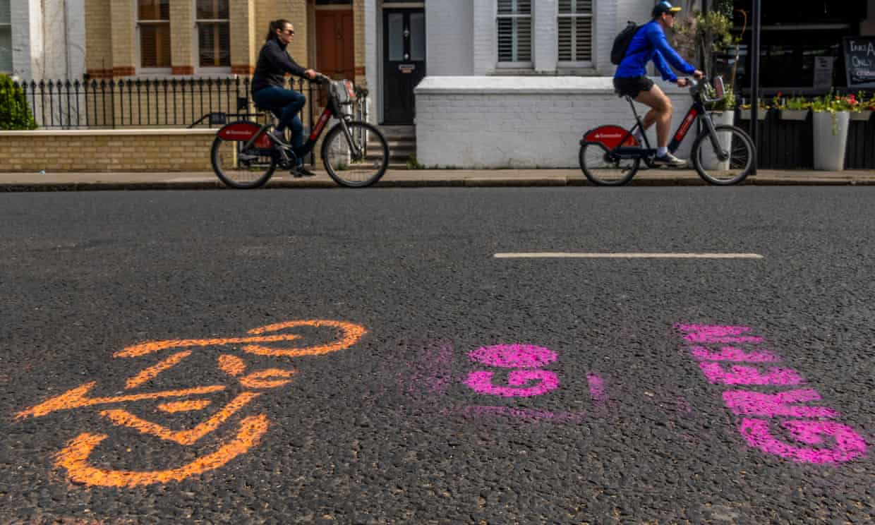 An Extinction Rebellion pop-up cycle lane in west London. Some countries are investing in better cycle lanes and electric vehicle charging points. Photograph: Guy Bell/Rex/Shutterstock