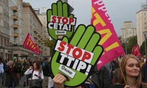 Consumer rights activists take part in a march to protest against TTIP and CETA in Berlin.