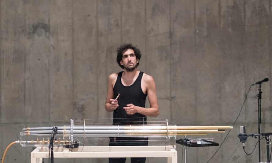 Tarek Atoui with the koto, a bundle of organ pipes set on a table frame, connected to an air compressor.
