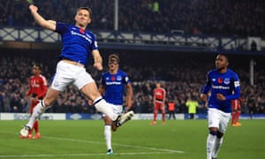 Leighton Baines celebrates scoring his side's third goal of the game from the penalty spot.