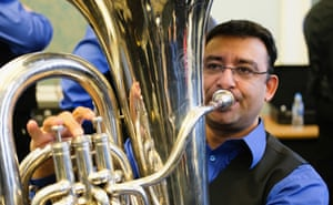 A musician from Knottingley brass band warms up