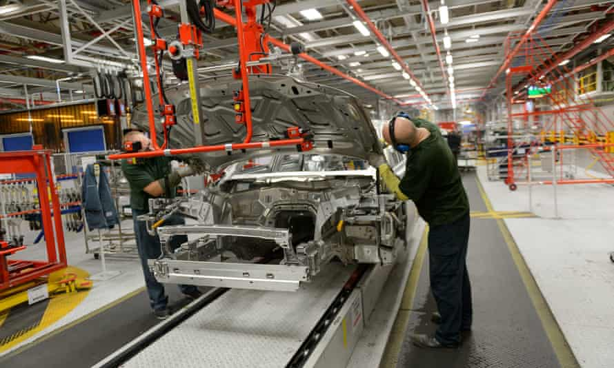 Workers at the Jaguar Land Rover factory in Castle Bromwich, West Midlands.