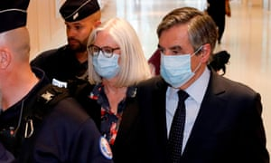 François Fillon (right) and his wife Penelope Fillon leave the Paris courthouse after being found guilty of fraud.