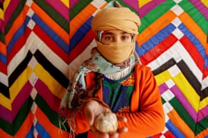 Salma Mohsen, 10, poses for a photo holding a truffle