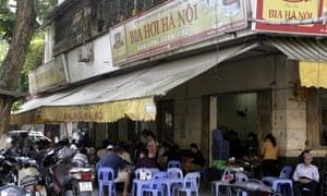 Vietnamese men drink beer at an outdoor beer parlor in Hanoi, Vietnam