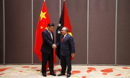 Papua New Guinea's PM Peter O'Neill shakes hands with China's President Xi Jinping