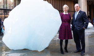Justine Simons, London's deputy mayor, and Michael Bloomberg, the UN's special envoy for climate action, with part of Olafur Eliasson's Ice Watch melting glacier artwork on Tuesday.