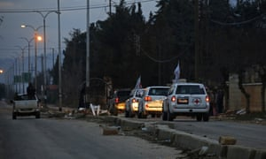 An aid convoy heads towards the besieged Syrian town of Madaya, north-west of Damascus.