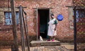 Magdalene Masifako outside her home, now honoured with a blue plaque, in Kliptown, Soweto.