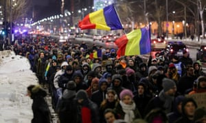 Protesters in Bucharest demonstrate against government plans to grant prison pardons through emergency decree.