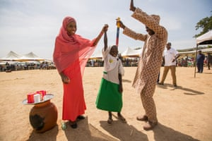 Dorcas celebrates after receiving the billionth NTD treatment delivered by Sightsavers and its partners