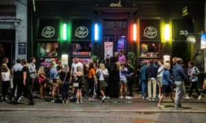 People gather in front of the Ibiza Beach Bar in Copenhagen last month.