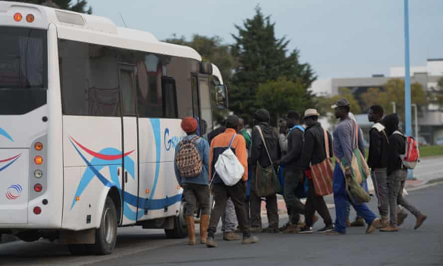 Migrant day labourers wait for employers to pick them up to collect fruit near Lepe, Huelva, southern Spain.
