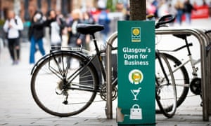 A sign reads 'Glasgow's Open for Business' in Glasgow city centre on 28 May.