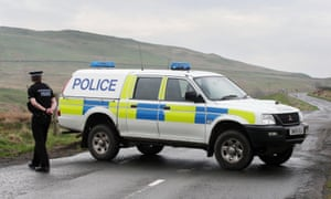 A Scottish police car and officer