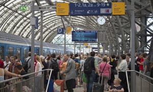 Passengers wait for delayed trains at the main station in Dresden, Germany.