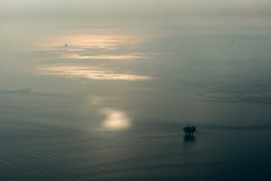 Aerial view of oil drilling platforms in the smoke from wildfires near Anchorage, Alaska, USA.