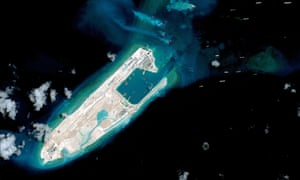 China has landed a plane at an airstrip at the top end of Fiery Cross Reef in the Spratly Islands in the disputed South China Sea.
