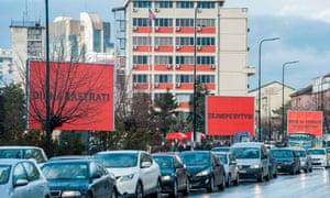 Three billboards on a road near the police headquarters in Pristina, Kosovo