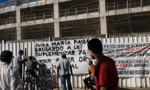 Residents of Vila Autodromo, a favela next to the Olympic Park, hang banners in protest at the demolition of homes.
