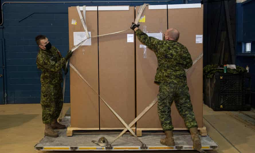 Canadian Armed Forces personnel load freezers for Covid-19 vaccines near the Ottawa airport on 12 December, a week after Ladislas Kenderesi urged fellow soldiers to disobey orders.