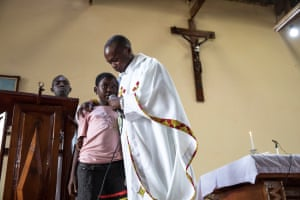 Rachel an ebola survivor during messe and requiem at the Mangina church in DRC.
