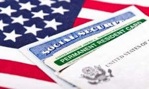 A social security card and a green card.