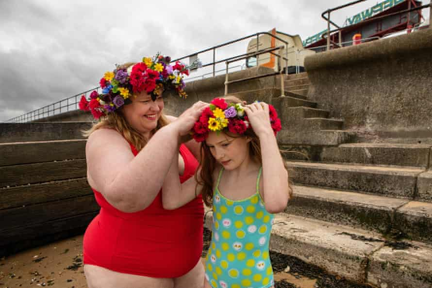Anna Morell helps her daughter Aurelia put on her floral wreath.