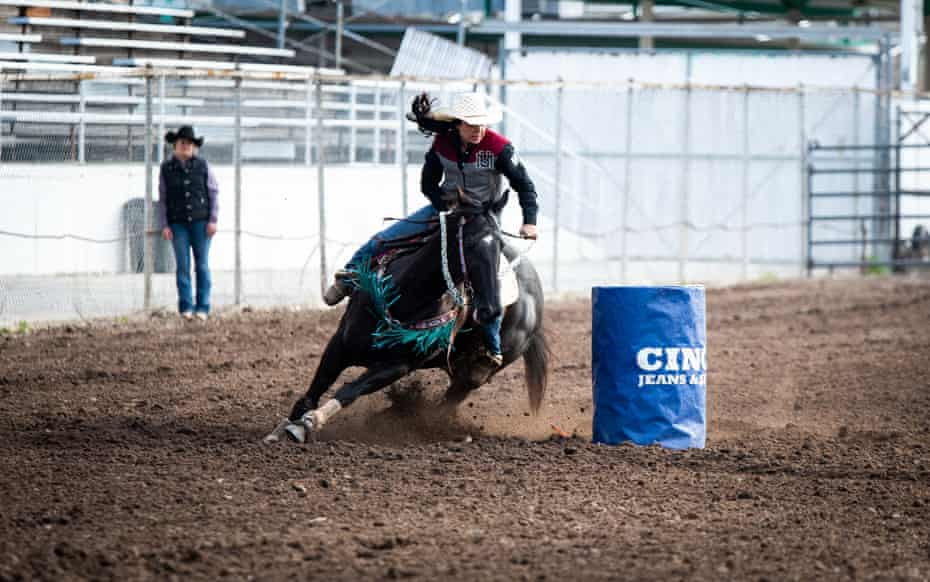 Simonson rides Diesel around a barrel during the barrel race at the UM Rodeo in April, 2019. The announcer described Keira as the best in the region, and Diesel as the fastest black horse he'd seen.