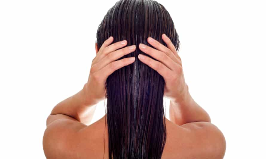Back view of woman with long wet hair