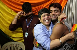 Activists in Mumbai embrace after the supreme court decision