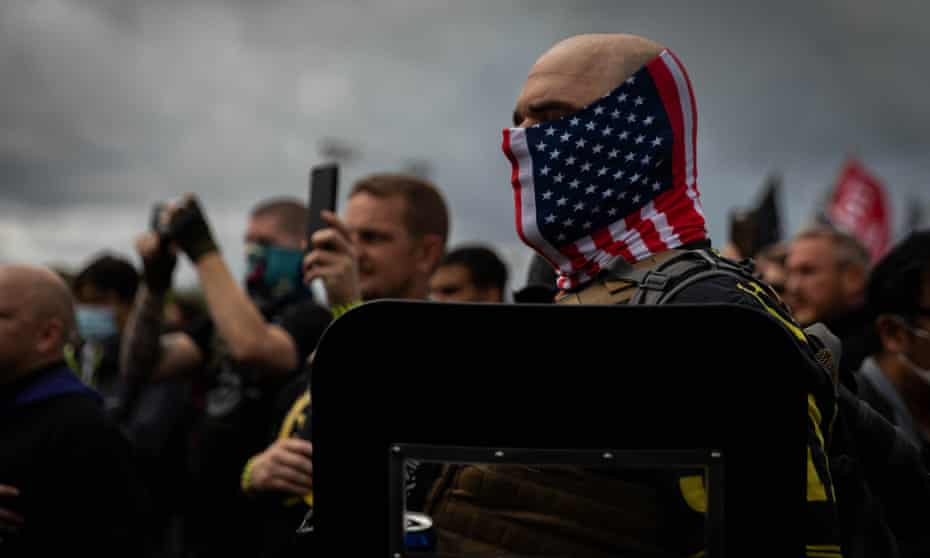 Proud Boys organizer recites the Pledge of Allegiance during a Proud Boys rally at Delta Park in Portland, Oregon on 26 September 2020.