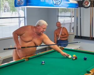 George Lane shoots pool in Lake Como's recreation room.