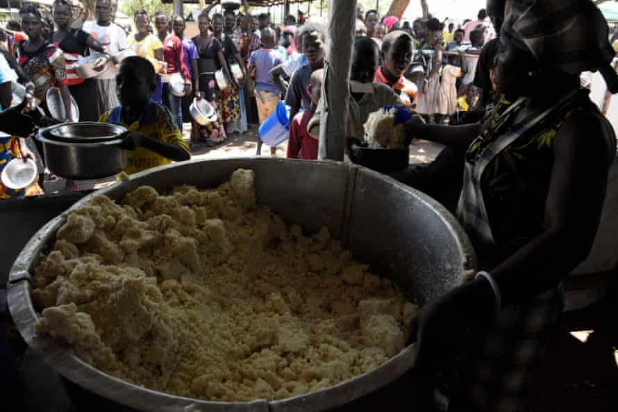 South Sudanese refugees queue for their lunch at Imvepi reception centre