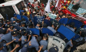 Police and protesters clash during the violent protest outside the US embassy in Manila, Philippines