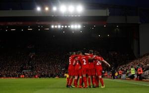 Mane celebrates with his Liverpool teammates.