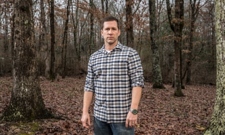 Photograph of Andy Peterson in a wood