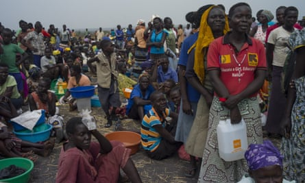 Refugees queue for rations from the World Food Programme at a refugee settlement in Palorinya, Uganda