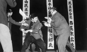 Seventeen-year-old Otoya Yamaguchi uses a foot-long sword to kill Japan Socialist Party leader Inejiro Asanuma, on a public stage in Tokyo, 12 October 1960.