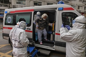 An elderly woman arrives in an ambulance to Wuhan Red Cross Hospital