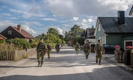 Swedish armed forces patrolling a village street in Gotland