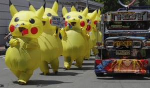 Manila, Philippines Environmental activists wearing Pikachu costumes hold a rally outside the Japanese embassy