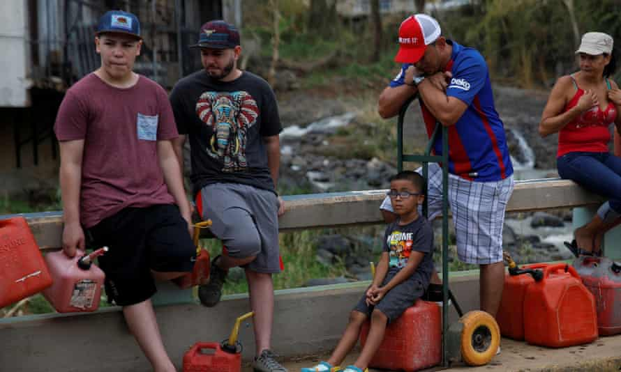 Puerto Rico wait for fuel in Orocovis, outside San Juan. More than a third of Puerto Ricans are still struggling to live without drinking water.