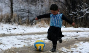 Murtaza Ahmadi, 5, wears his homemade Messi shirt in tribute to the Argentinian star.