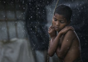 Rohingya boy in the rain