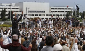 Protesters gather near the parliament bulding in Islamabad.