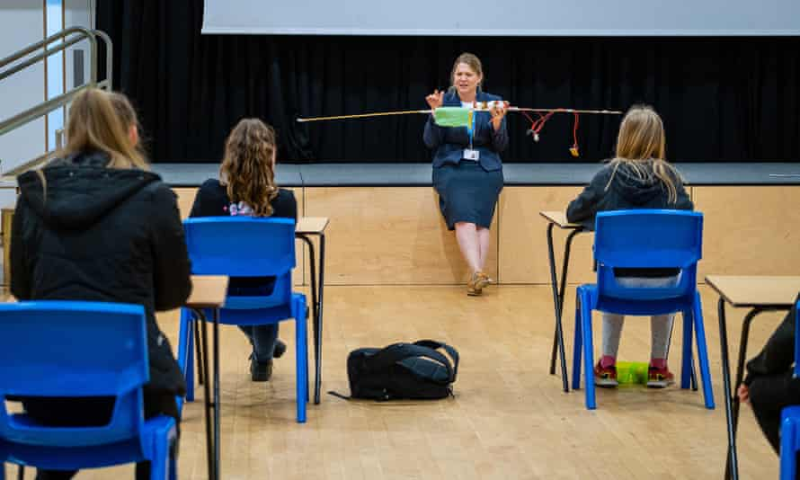 Kerala Cole, assistant head, demonstrating the 2 metre safe zone in assembly.