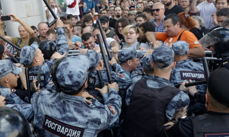 Protesters clash with police during an 'unsanctioned' rally in Moscow on 27 July
