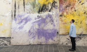 A gallery visitor studies work by Jessica Warboys at Tate St Ives