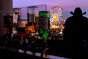 A cowboy looks at the rodeo carnival fairgrounds